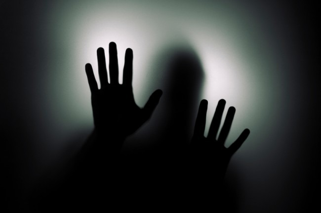 Hands-behind-window-650x432